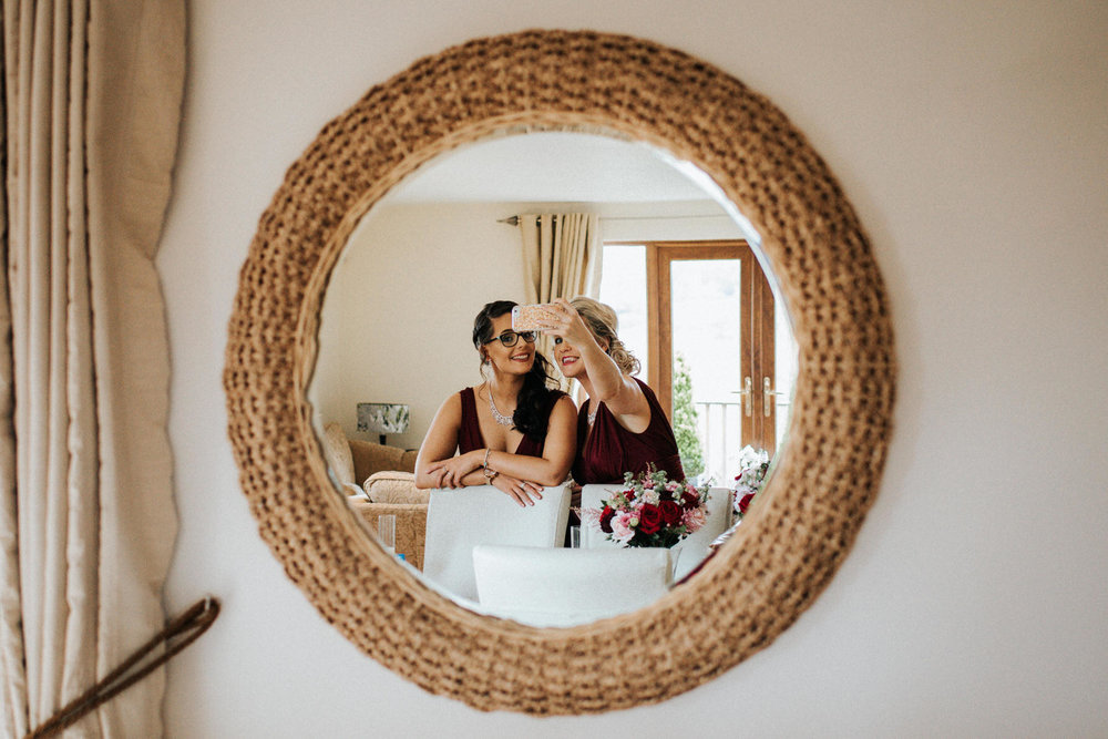 Cheshire Wedding Photojournalism - bridesmaids selfie reflection in the mirror