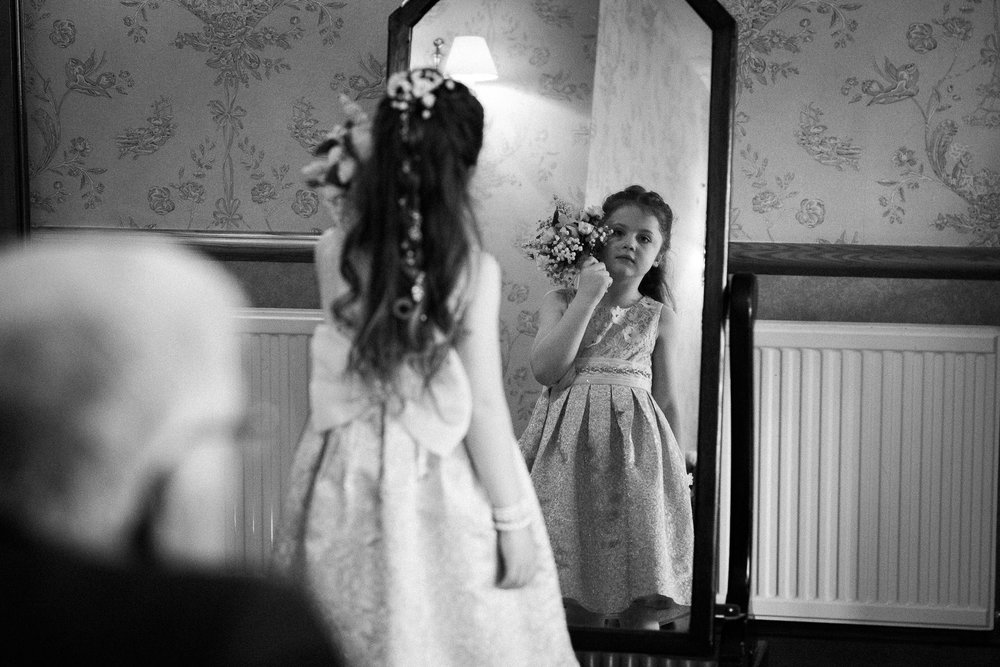Cheshire Wedding Photojournalism - Bridesmaid looking in mirror