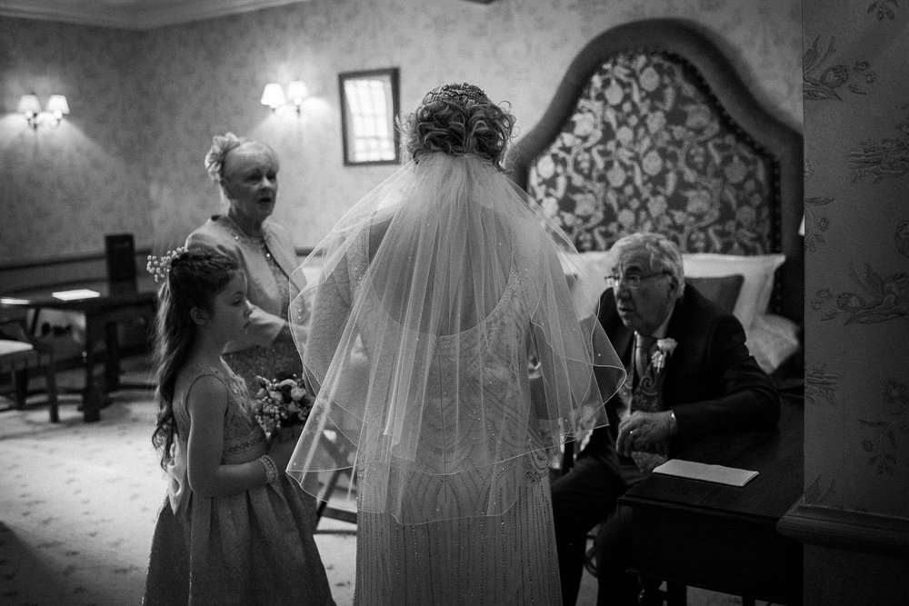 Cheshire Wedding Photojournalism - A bride with her daughter and parents