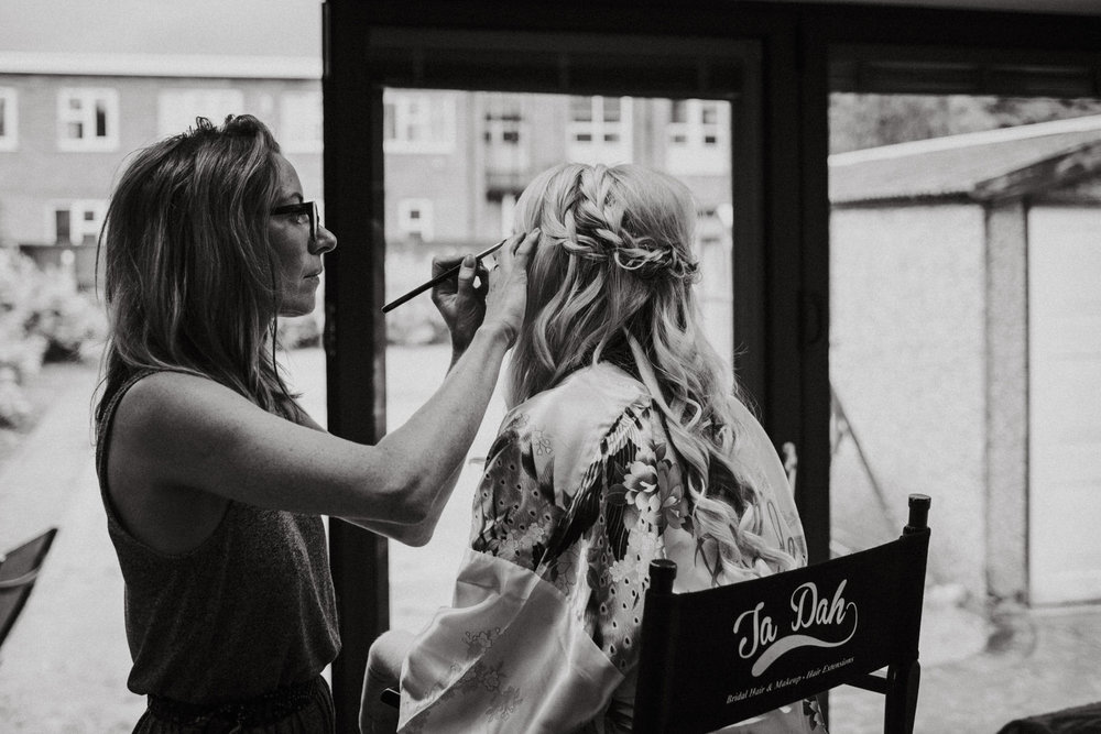 Wedding Photojournalism - Bride having her make up done for her wedding