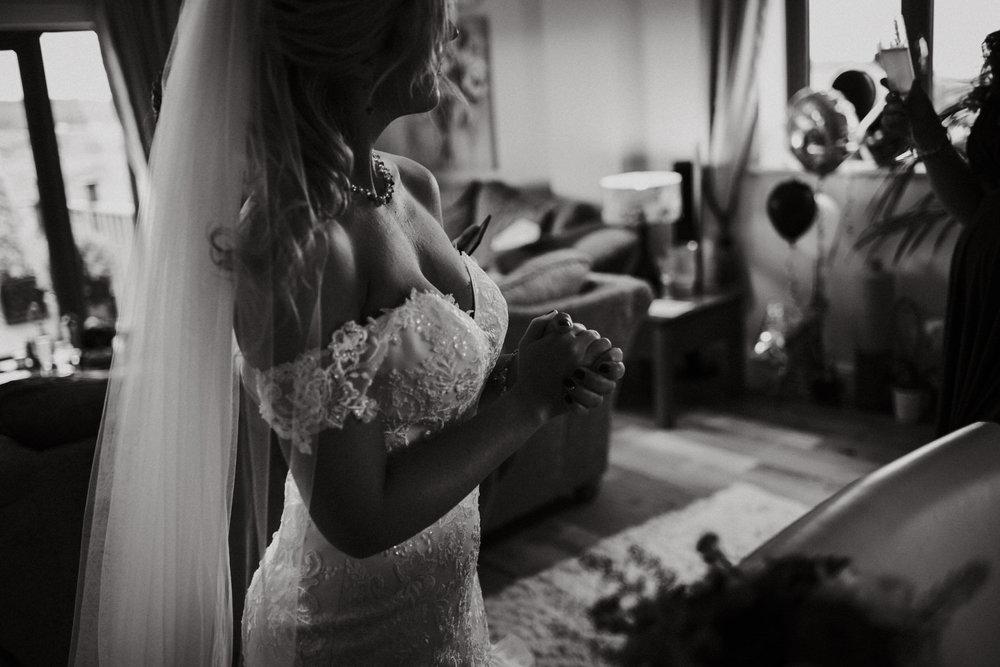 Wedding Photojournalism  - A bride in her wedding dress