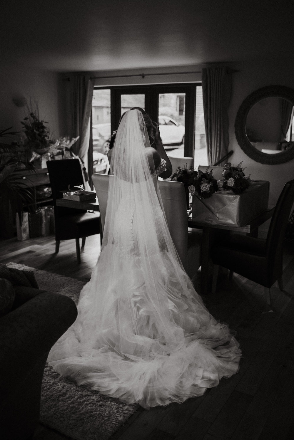 Cheshire Wedding Photojournalism -back of brides wedding gown