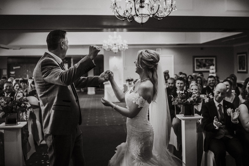 Cheshire Wedding Photography - wedding ceremony fist pump