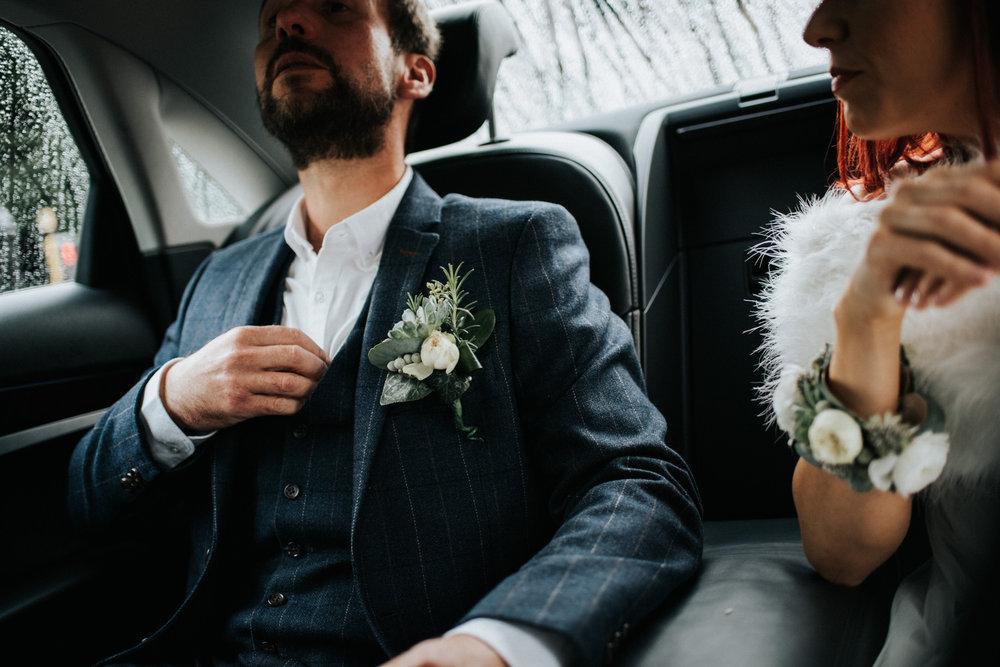 Wedding Photojournalism - bride and groom in wedding car