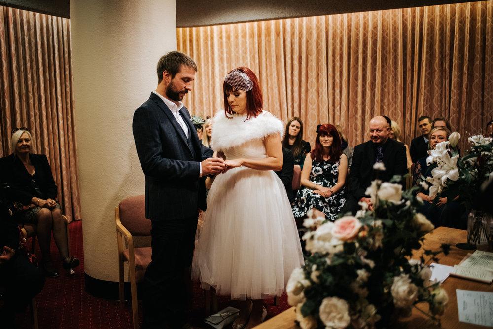 Wedding Photojournalism - Bride and groom exchange rings