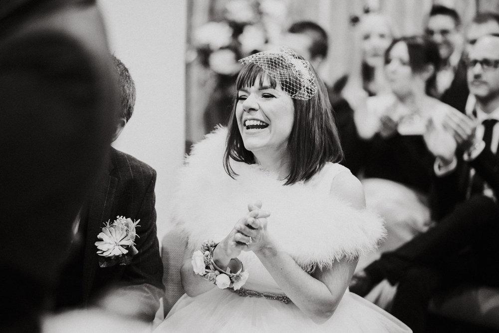 Wedding Photojournalism - bride laughing