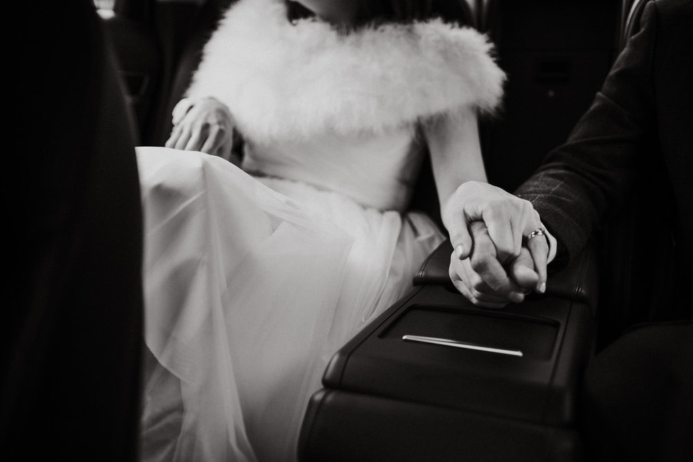 Wedding photojournalism - bride and groom holding hands