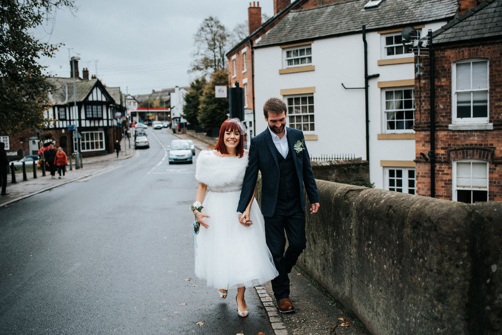 Wedding Photojournalism - Bride and groom walking in Chester