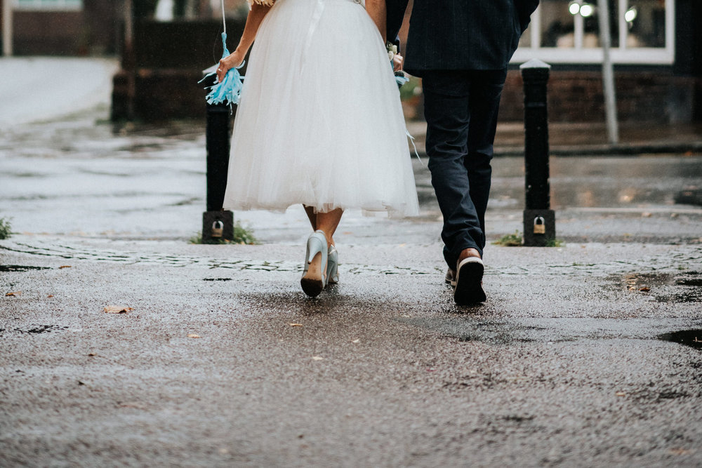 Wedding Photojournalism - Bride and groom walking away