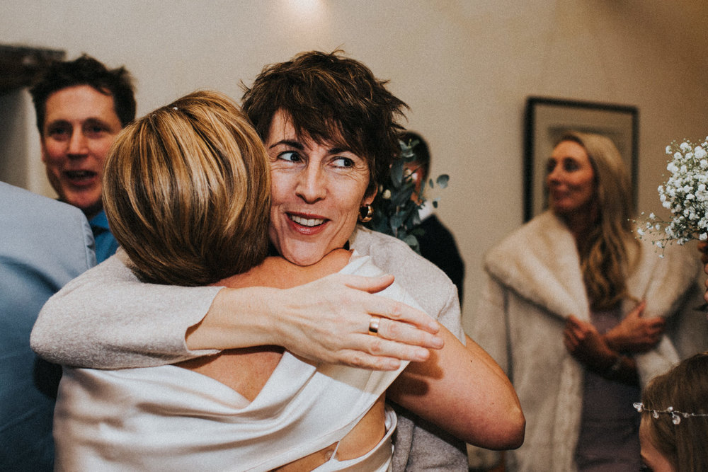 Documentary Wedding Photography bride hugging wedding guest
