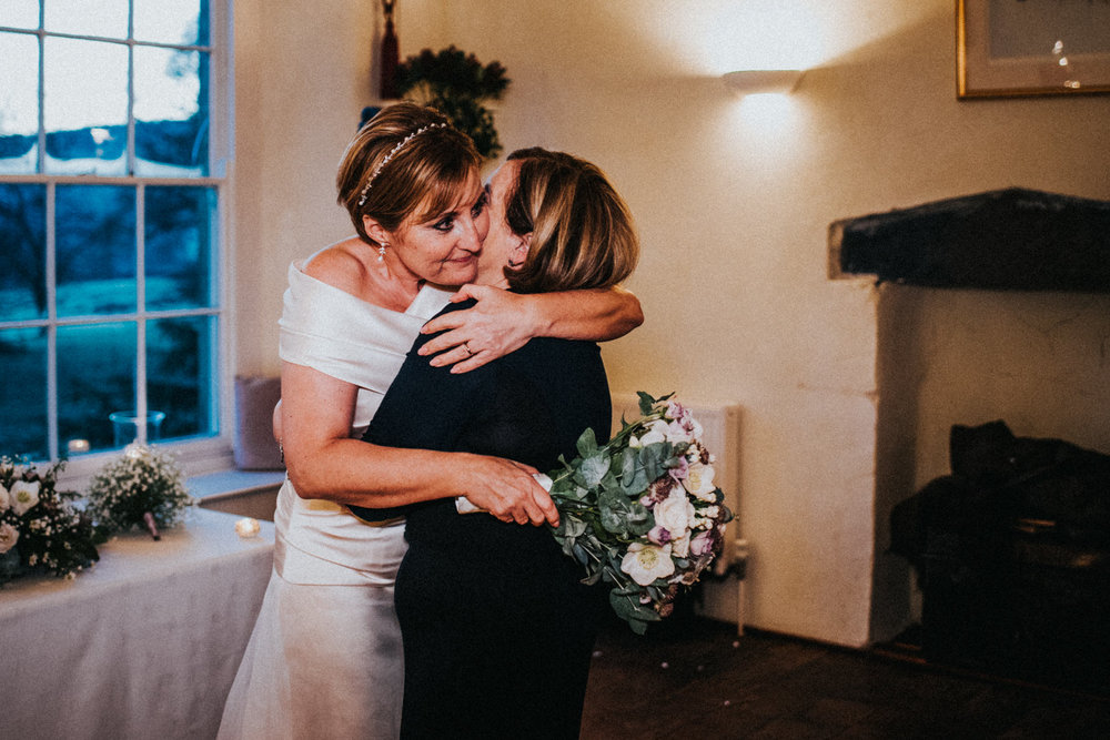 Documentary Wedding Photography a bride hugs her mum
