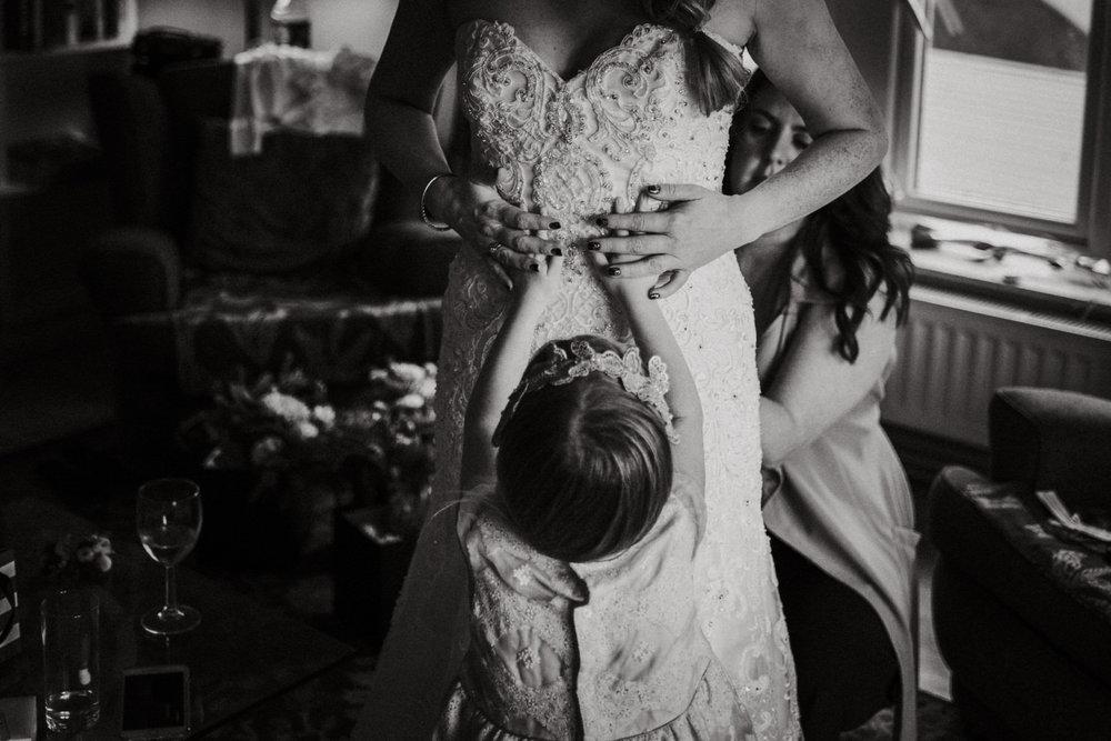 Flower girl and bride in wedding dress