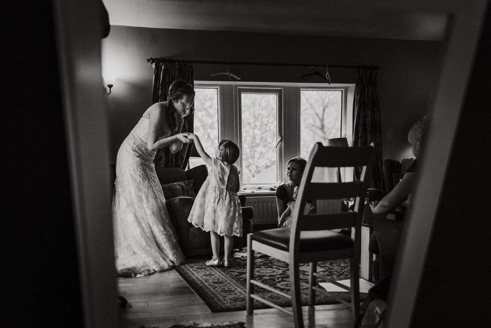Bride and flower girl in black and white