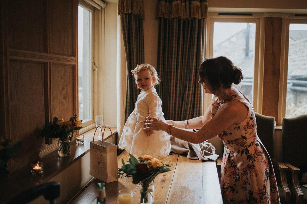 Documentary-wedding-photography-flower-girl-and-grandma