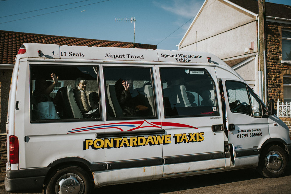 Wedding Photojournalism - bridal party arriving by minibus