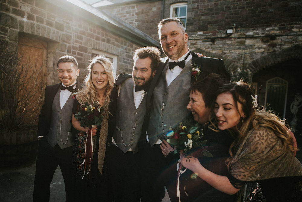Wedding Photojournalism - A groom with his family