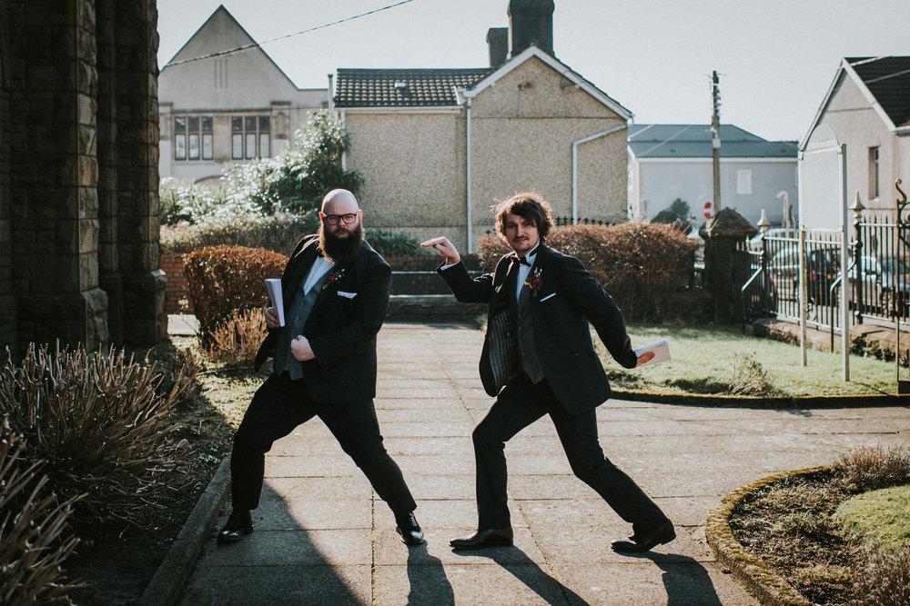 Wedding Photojournalism - Groomsmen striking a pose.