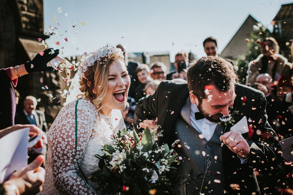 Wedding-Photojournalism-bride-and-groom-confetti-shot