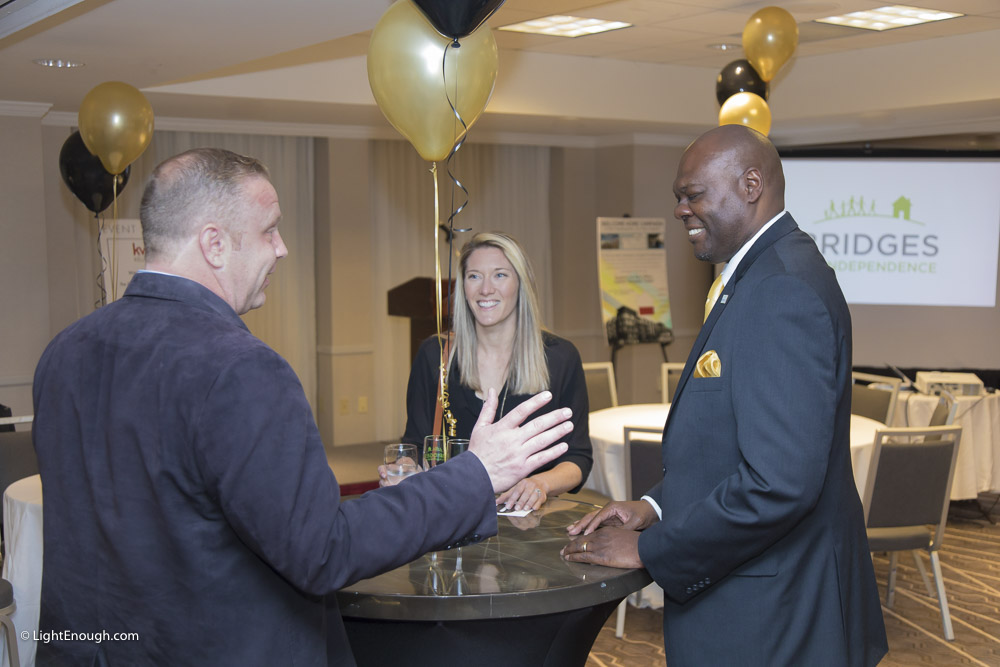 B2I Executive Director Sam Kelly (right) chats with guests at the Bridges to Independence Black & Gold Gala May 19, 2017. Photos by John St Hilaire of LightEnough.com
