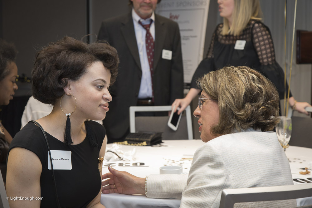 Amanda Moreau and friend having a chat at the Bridges to Independence Black & Gold Gala May 19, 2017. Photos by John St Hilaire of LightEnough.com