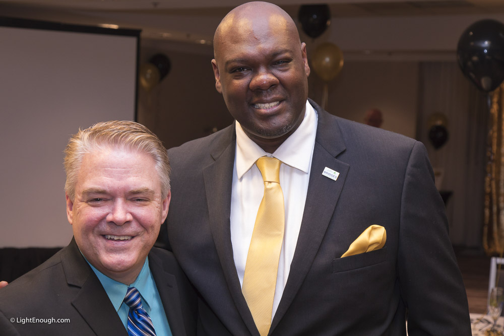 Event emcee Scott Taylor of WJLA TV and B2I Executive Director Sam Kelly at the Bridges to Independence Black & Gold Gala May 19, 2017. Photos by John St Hilaire of LightEnough.com