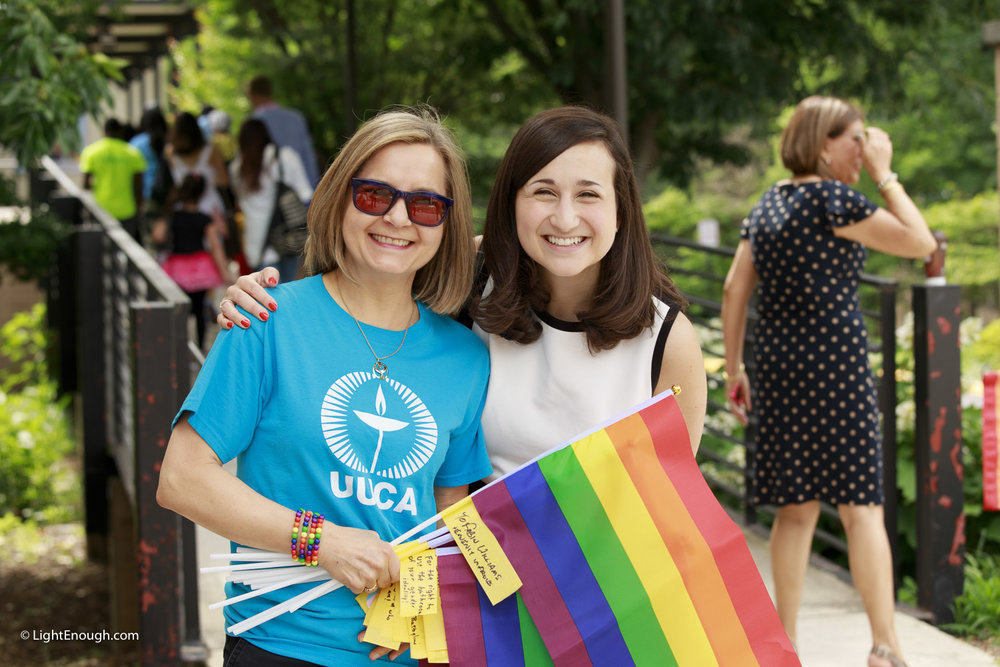 Elizabeth Fogarty of UUCA chats with Arlington County Board Vice Chair Katie Cristol at UUCA Pride Flag day on Saturday June 3, 2017. Photo by John St Hilaire/LightEnough.com.