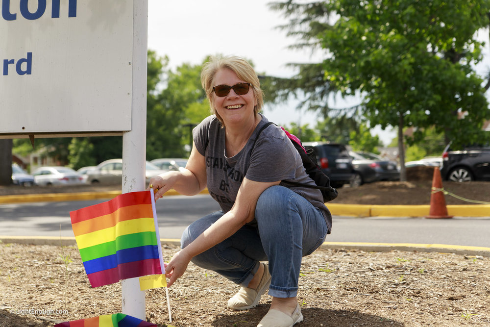 Planting Pride Flags at Pride Flag day on Saturday June 3, 2017. Photo by John St Hilaire/LightEnough.com.