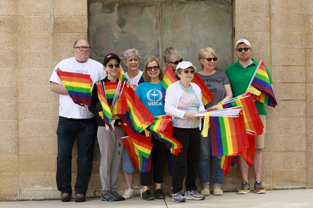UUCA members prepare to plant Pride Flags at Pride Flag day on Saturday June 3, 2017. Photo by John St Hilaire/LightEnough.com.