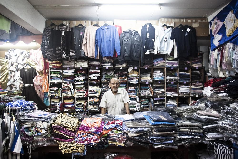 """Saint-Pierre, Ile de la Réunion. Novembre 2012.M. Abdou Hamid Sulliman, employé au magasin de prêt à porter le """"Bonmarché"""" depuis 1982 dans le centre ville de Saint-Pierre."""