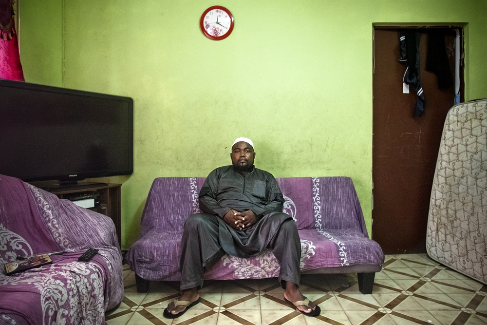 Saint-Pierre, Ile de la Réunion. Décembre 2012.Portrait de M. Saïd Abdou. Ancien imam de la mosquée de Saint-Pierre, il aide aujourd'hui la communauté en donnant des cours de coran et pratique aussi le slam dans le but de parler de l'islam autrement. M. Abdou est arrivé sur l'île en 1976 à l'âge de 7 ans, et est originaire de Mayotte. Sa famille a quitté son île afin de trouver une meilleure vie sur la Réunion.