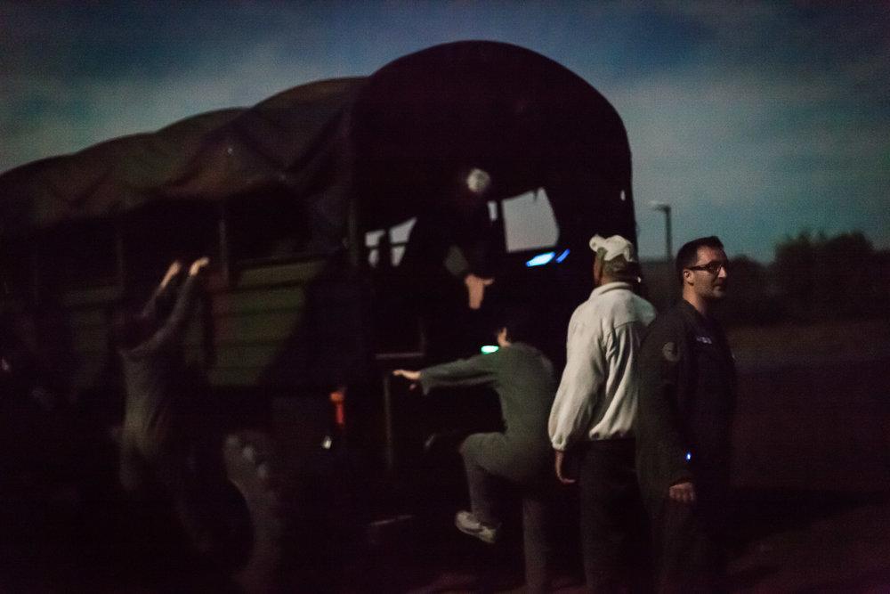 Coëtquidan, le 17 Octobre 2013. Après le dîner, les cadres de Veolia venus suivre un stage de leadership à Saint-Cyr partent au clair de lune faire un exercice nocturne sur un terrain d'entraînement militaire.Coëtquidan, October 17, 2013. After dinner, Veolia executives following a leadership course at Saint-Cyr military school, make a night exercise at a military training ground.
