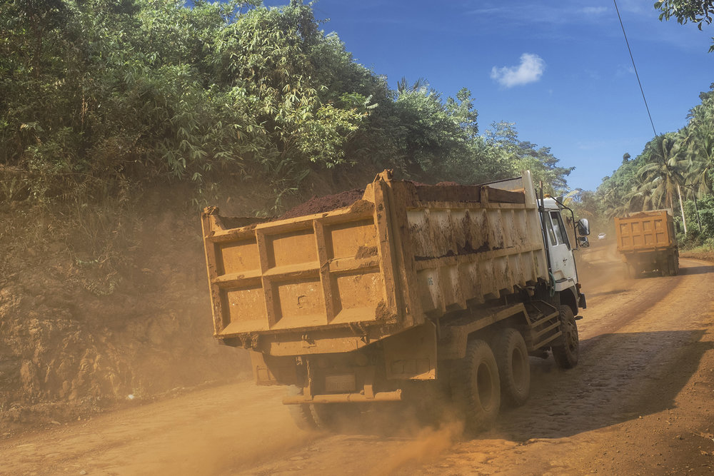 Everyday scene in Carasscal region heavily impacted by mining. Most of the trucks transport the ground from the mining sites to the loading areas at the coastline. Surigao del Norte. Mindanao, Philippines, 04.2016