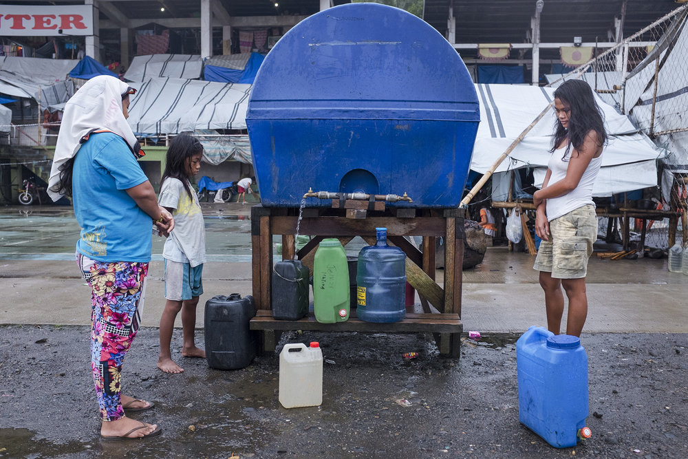 Potable water shortage is a real problem in the Bakwid evacuation centre. Tandag City, Surigao del Sur, Mindanao, Philippines, 04.2016