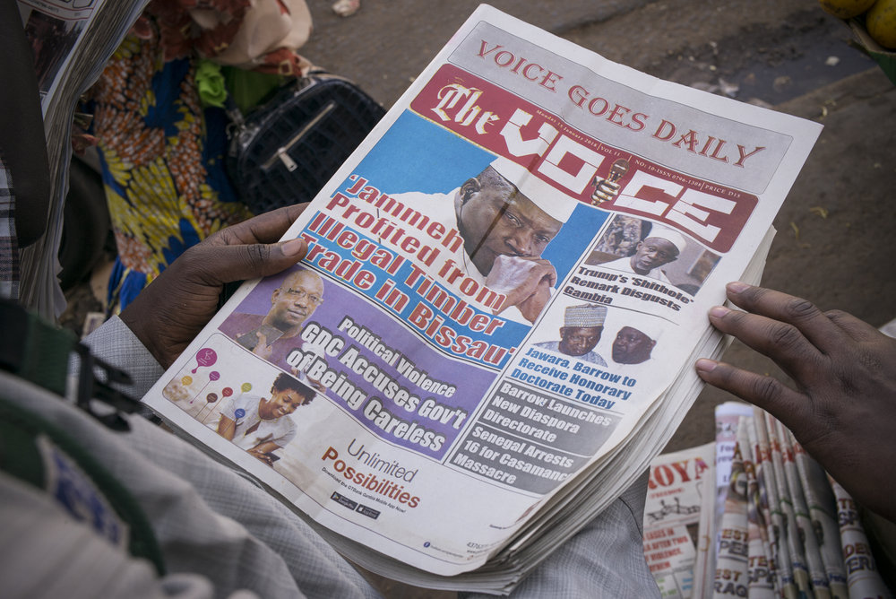 """Serrekunda, Gambia. January 2018On January 15, 2018, the newspaper """"The Voice"""" titles: """"Jammeh profited from illegal Timber trade in Bissau"""" and """"Trump's « shithole » remark disgusts Gambia"""".A year after the fall of Yahya Jammeh dictatorship, the Gambian press lives again. Freedom of expression is gradually coming back and the media field comes out of 22 years of self-censorship. Since January 2018, """"The Voice"""" newspaper has gone from three editions a week to five, a sign of the country's new appetite for information."""