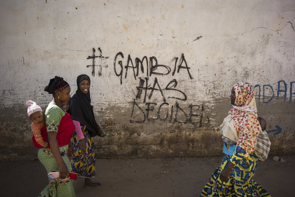 """Sukuta district, Serrekunda, Gambia. January 2018The hashtag """"Gambia has decided"""" appeared on the walls all over the country since December 9, 2016, the day when Yahya Jammeh refused his defeat and decided to remain in power, despite Adama Barrow's coalition majority of votes."""