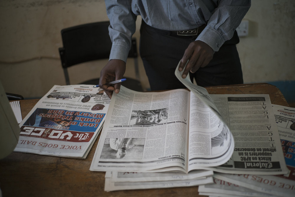 """""""The Voice"""" office. Serrekunda, Gambia. January 2018""""The Voice"""" newspaper was founded in 1997 and lived only two years before the authorities closed it. Pressures on journalists since Y.Jammeh's coup in 1994 have been very strong. The press sector, practiced self-censorship during the 22 years of the autocrat's reign, . All criticism was repressed. The newspaper restarted in 2008. It is now published three times a week."""