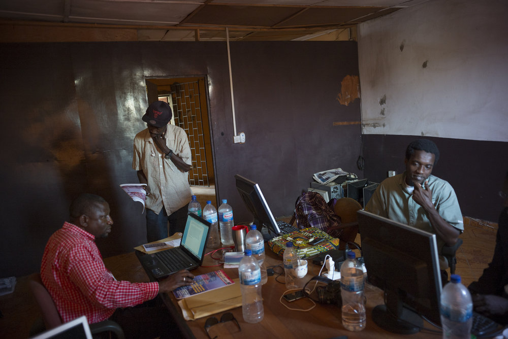 """""""The Voice"""" newsroom. Serrekunda, Gambia. January 2018Interns and freelancers share one of the newsrooms. The newspaper faces a lack of space for the 14 interns and 3 freelance staffers."""