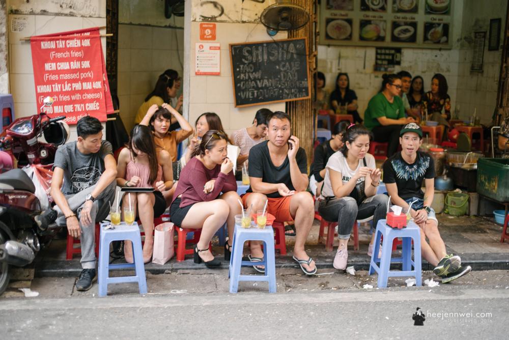 Restaurant by the sidewalk.