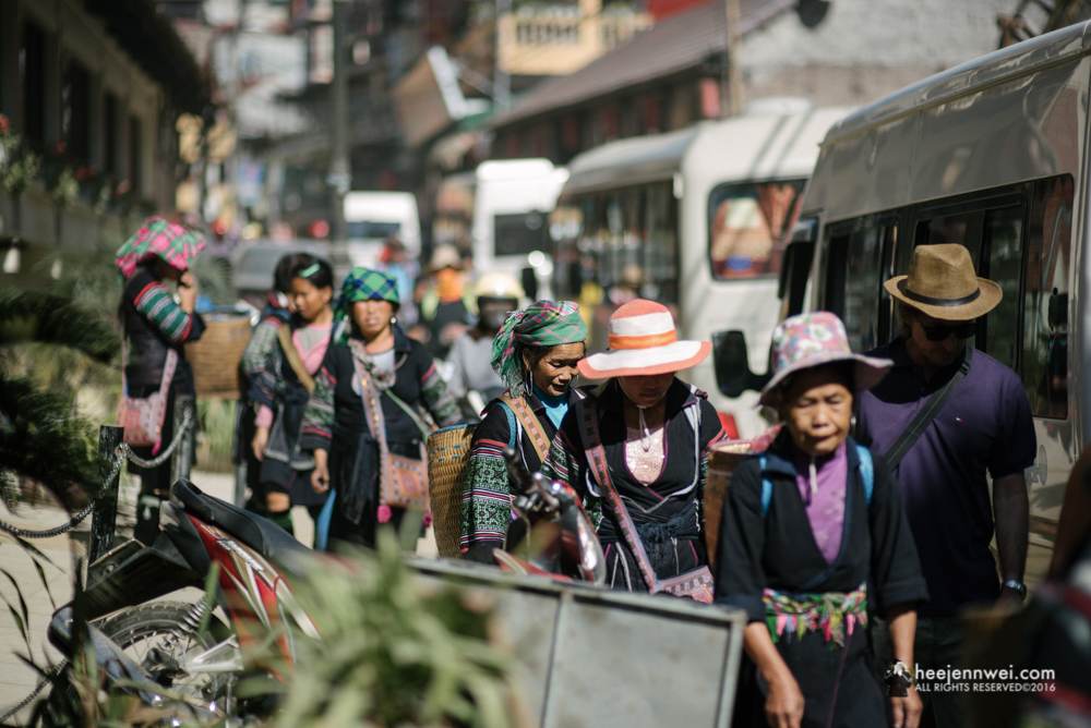 Crossing the hustle bustle Sapa tour, to the entrance to our treks.
