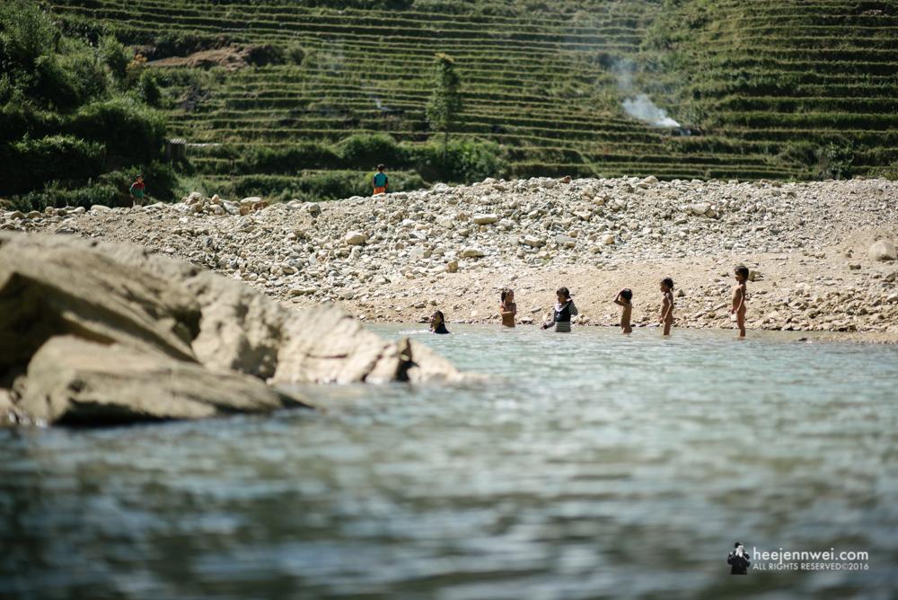 H'mong kids frolicking at the Muong Hoa River.