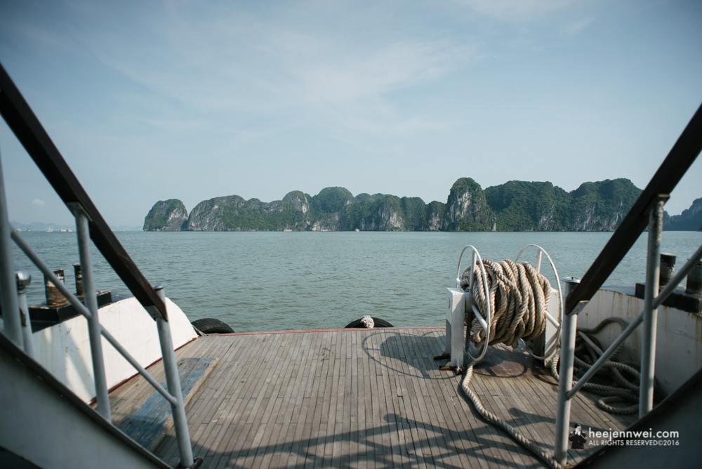 On the deck towards Halong Bay rock formation.