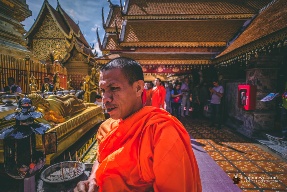 Praying monk at the chedi.
