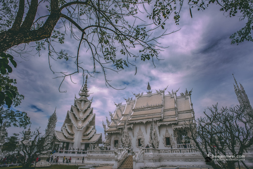 Started in 1997, Wat Rong Khun isn't a working temple but more an artistic expression and experience. Between the contrasting subject matter, surprising figures and blatant messages you don't normally find at temples.