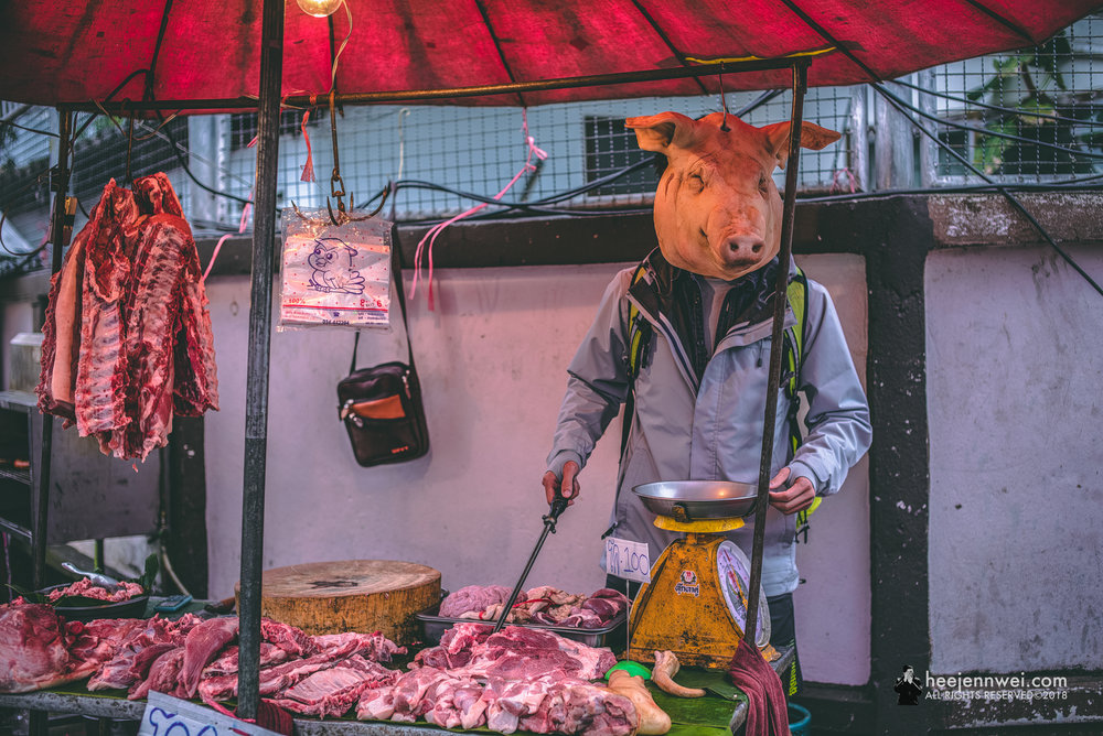"The wet market vendor was kind enough to have us ""man"" her butcher stall."