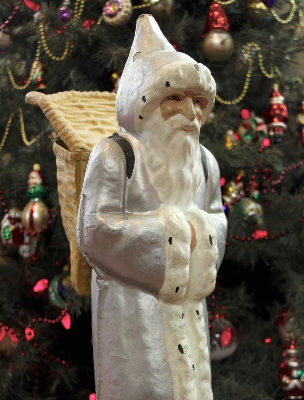 Pere Noel is the French equivalent of the American Santa Claus. He wears a long, hooded robe edged with white fur, and carries presents in a basket like those used by grape harvesters. This papier-mache figure of Pere Noel served as a candy container, and was featured in the Museum's  Christmas Traditions in Many Lands  exhibition (Friday, November 27, 2015 through January 10, 2016). Credit: Glencairn Museum.