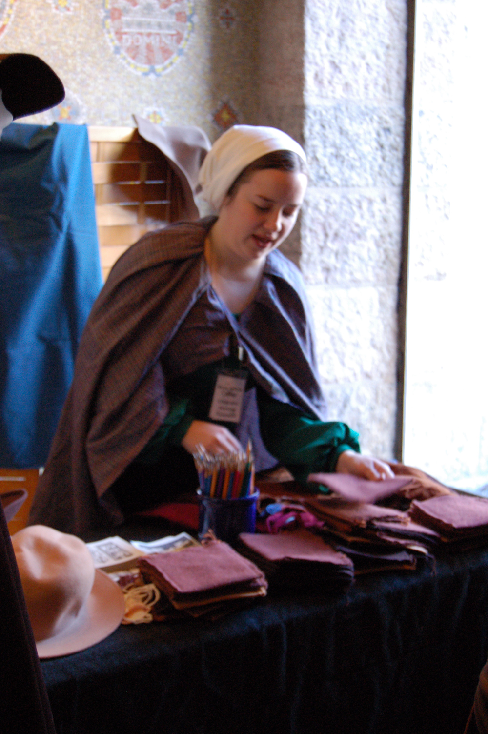 "The Vendor (a  Bryn Athyn College  student and Glencairn Intern) at her stall ""sells"" pilgrims the supplies they will need for their pilgrimage journey."
