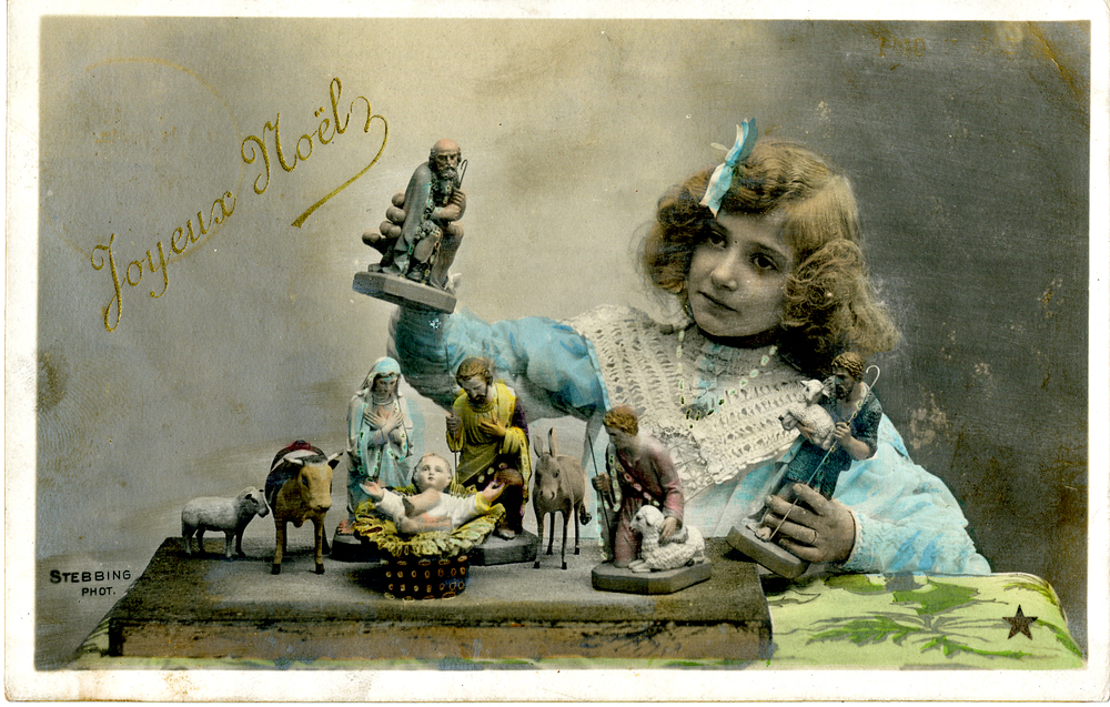 Hand tinted postcard of girl with crèche figures, circa 1910. Photographer: Professeur Stebbing, Paris, France. Publisher: Étoile, Paris. Collection of Ed Gyllenhaal.