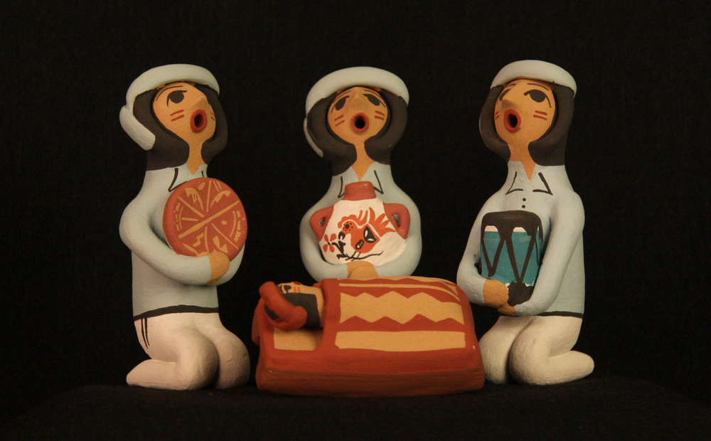 """This Pueblo Indian Nativity (nacimiento) was made in 2011 by Cheryl Fragua of the Jemez Pueblo, New Mexico, using clay and natural pigments. Most of the residents of the Pueblos have accepted Christianity as an addition to their own pre-Christian traditions. Today a number of Pueblo Indian artisans make Nativities regularly, along with other works such as the famous ceramic storyteller figures. Indian culture is rich with myths and stories, which are used to convey traditions and values. The storyteller and Nativity figures usually have closed eyes and an open mouth in order to """"let the stories out."""" Collection of Glencairn Museum."""