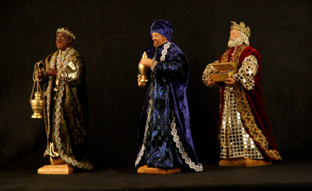 """Santons from France made from fired clay, cloth, and other materials, 2008. The French Revolution played a role in establishing the tradition of santons or """"little saints."""" Before the churches in France were closed in 1794 it was customary for them to put on Nativity plays; when the revolutionary authorities banned these plays individuals began to set up Nativities in their own homes. Santons come in a variety of sizes. These large figures of the three wise men were made by an artist signed """"Marie,"""" from Saint-Maximin-la-Sainte-Baume. Collection of Glencairn Museum, gift of Alan and Mary Liz Pomeroy."""