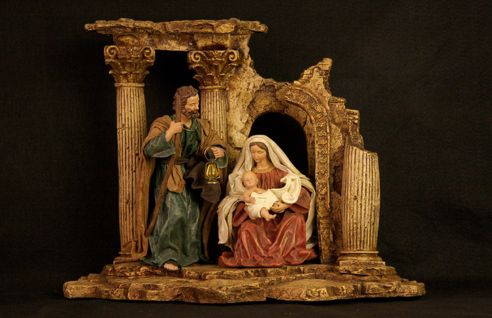 This contemporary Nativity scene, made in China, reflects an old artistic tradition. In paintings of the Italian Renaissance, ruined Roman architecture was sometimes used in the background of a Nativity scene to symbolize the fall of the old order (paganism). Within the crumbling temple is the Holy Family, representing the birth of the new order (Christianity). Collection of Glencairn Museum, gift of Rita Bonaccorsi Bocher.